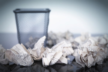empty Paper bin with paper balls arround