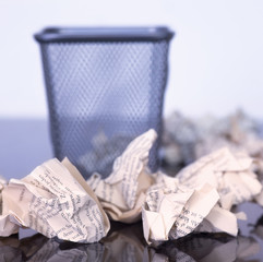 empty Paper bin with paper balls arround