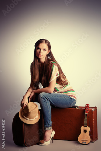 sitting on suitcases