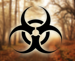 Biohazard symbol against nature background