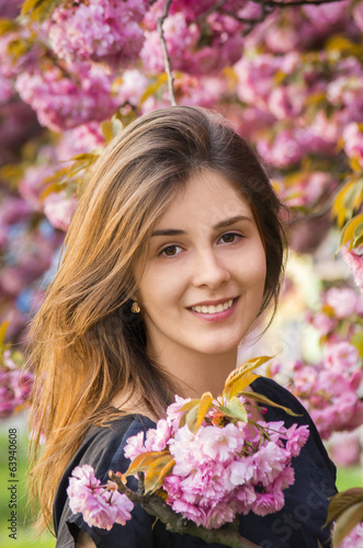 happy girl in the flowers of sakura
