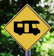 Yellow traffic label with camping bus pictogram