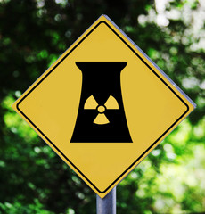 Yellow traffic label with nuclear power station pictogram
