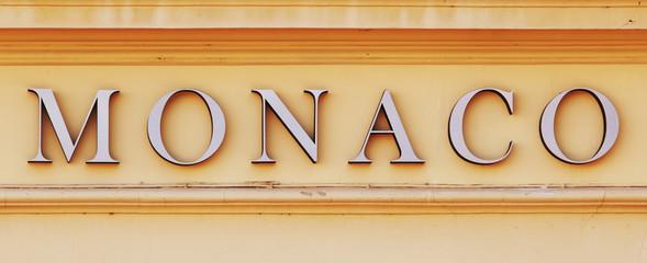 Monaco text on yellow wall