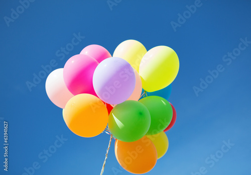 lots of colorful balloons in the sky