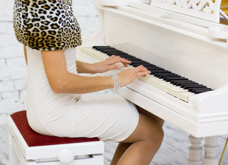Profile of woman playing piano