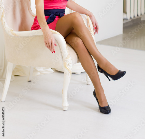 Girl siting in a white chair