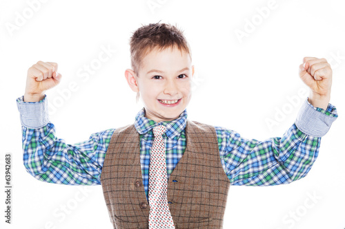 boy showing his hand biceps muscles strength