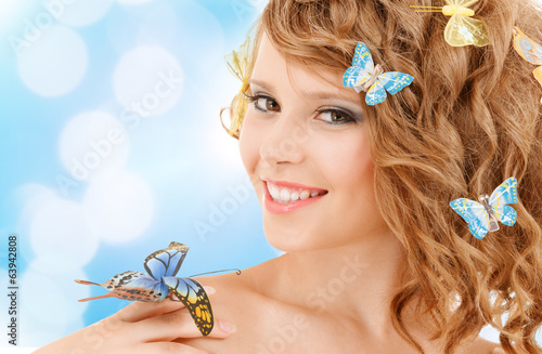 happy teenage girl with butterflies in hair