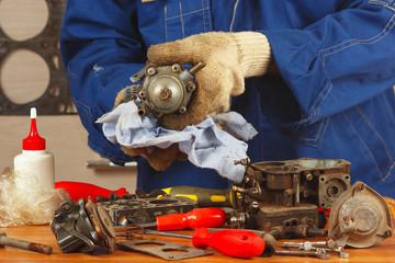 Master repairing the old car engine fuel pump