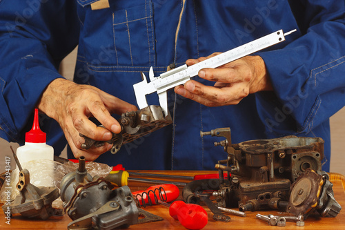 Repair of parts of automotive engine in the workshop