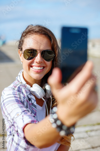 canvas print picture smiling teenager taking picture with smartphone