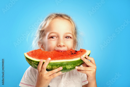Girl eats watermelon