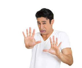 No, don't come closer, stop! scared young man, white background