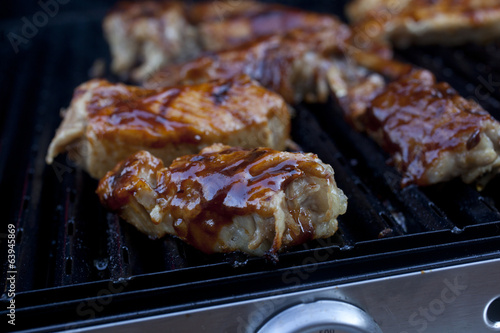 Barbecue pork cooking on a grill