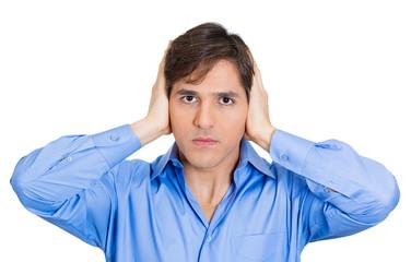 Hear no evil concept. Man covers ears, avoiding situation