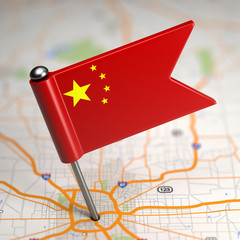 China Small Flag on a Map Background.