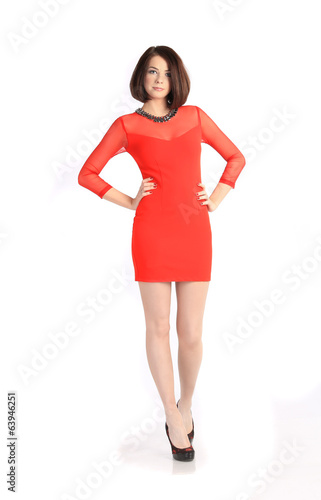 girl in short red dress on white background