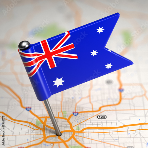 Australia Small Flag on a Map Background.