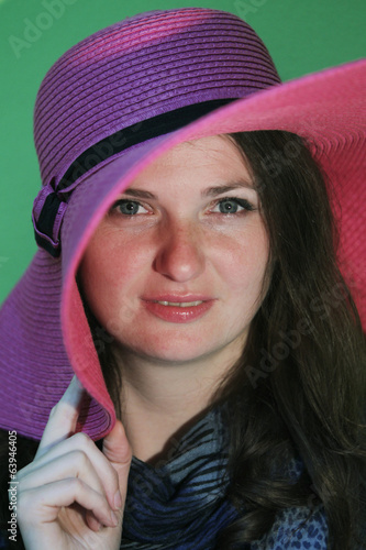 Charming brunette with pink hat