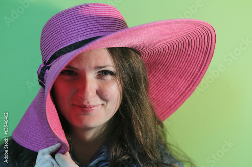 Lovely brunette with pink hat