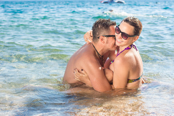 Smiling couple enjoying in water