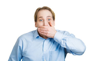 Disbelief surprise. Man covers his mouth with hand, shocked