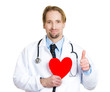 Heart healthy diet.Smiling doctor holding red heart