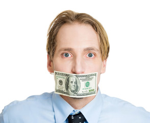 Bribes. Business man with hundred dollar bill over his mouth