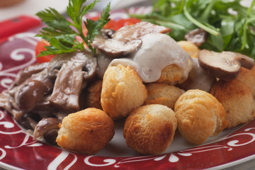 Roasted potato croquettes with portabello mushrooms