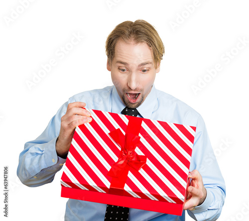 Surprised, happy business man receiving great gift