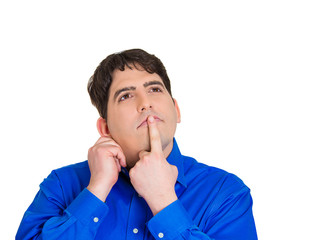 Confused young man trying to remember important information