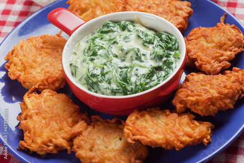 Spinach cream soup with potato pancakes
