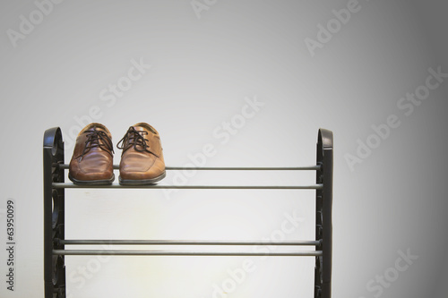 Shoes on shoe rack