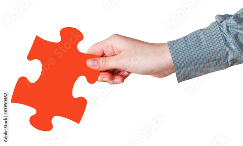 female hand with red puzzle piece