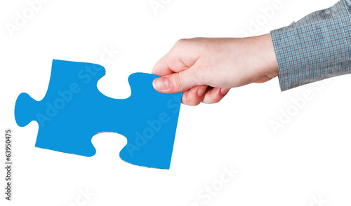 female hand with blue puzzle piece