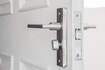 steel door knob on the white door