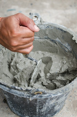 Applying construction trowel in wet cement