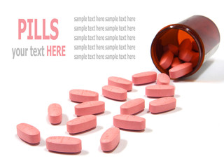 Pills spilling out of a pill bottle isolated background