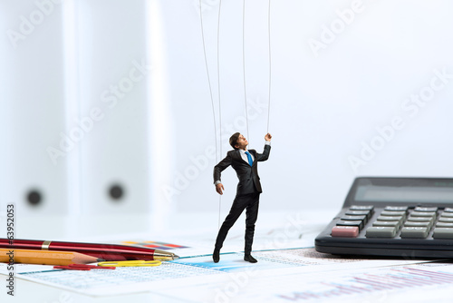 businessman puppet doll is on the desk