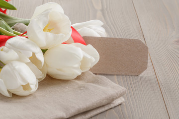 white tulips on wood table