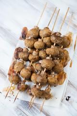 Baked mushrooms kebabs, vertical shot, high angle view