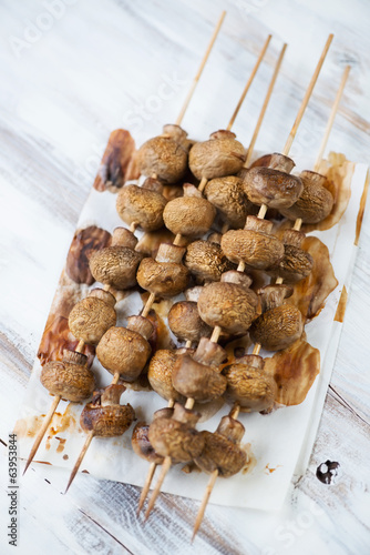 Baked mushrooms kebabs, vertical shot, high angle view