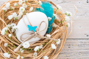 Egg in nest, easter rustic background, card, your text