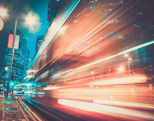 Fast moving cars at night in modern city