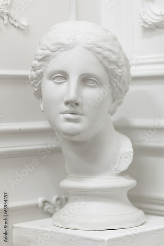 White marble head of young woman isolated on white - 63954457