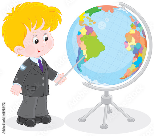 Schoolboy points to a country on a big globe