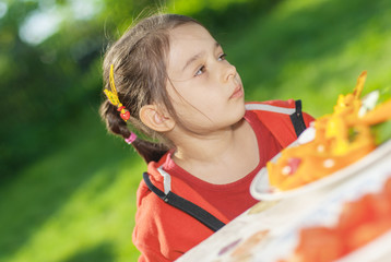 young Girl eats vegetables
