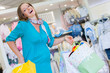 Pregnant woman in baby shop store