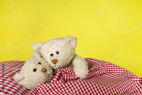 canvas print picture Concept for love - two toy teddy bears in the bed.